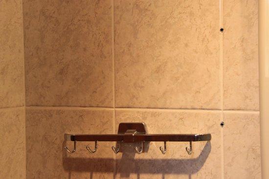 Hotel Makednos: Broken stuff with rusty screw holes...