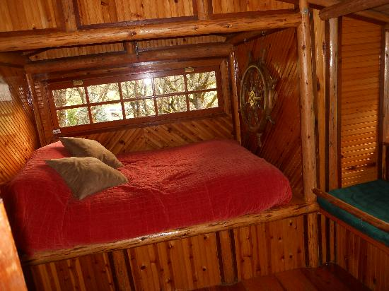 Out 'n' About Treehouse Treesort: bed in one of the rooms