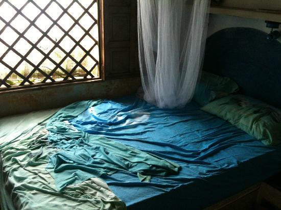 Posada Tropicana: Angolo letto