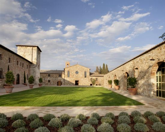 Castello di Casole Private Estate & Spa: Limonaia Garden and views of San Tommaso Chapel