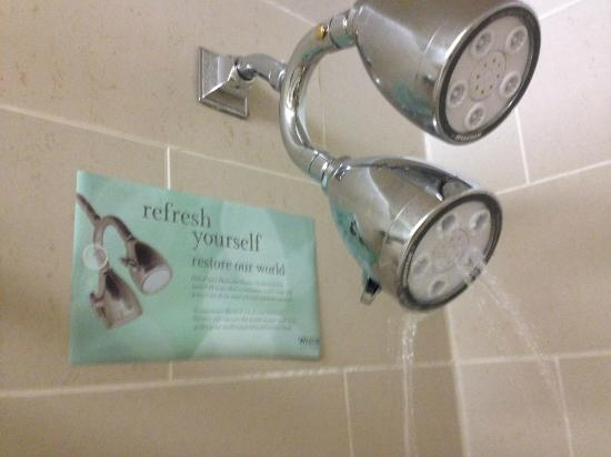 "The Westin Indianapolis: Lack of water out the shower head. And their ""green"" sign about saving water."