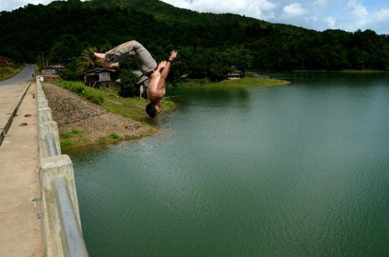 Uncle Tom's Trails - Private Day Tours: Backflipping into the refreshing lake