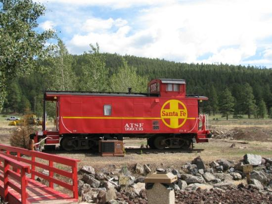 Canyon Motel & RV Park: Caboose No. 2 (main road behind it)