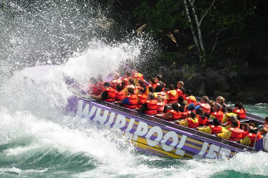 Whirlpool Jet Boat Tours: Watching a boat from the shore