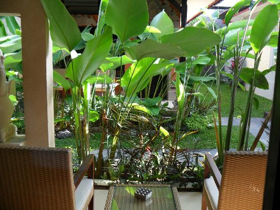Natya Hotel Tanah Lot: Patio chairs & table with semi-privacy plants