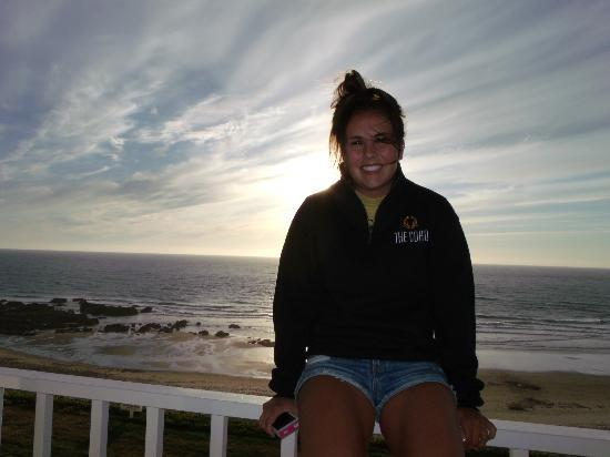 The Coho Oceanfront Lodge: My daughter on the deck of our room as the sun sets