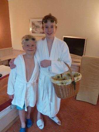 Hotel Salzburgerhof: Boys enjoying the bathrobes/slippers and basket!