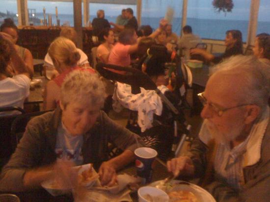 Sandy's Snack Bar : Two happy customers enjoying the food, view, and smell of the ocean.