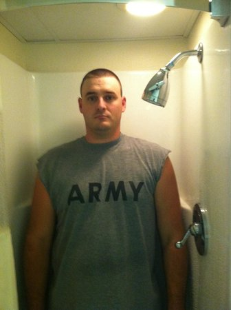 Baymont Inn & Suites Branson - On the Strip: The shower is the exact width of my husbands shoulders he touches both walls