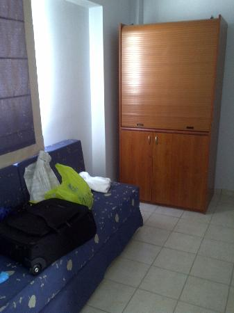 Dimitra Beach Hotel: hall area of apartment with spare sofa bed and kitchenette (not used as we were all inclusive)