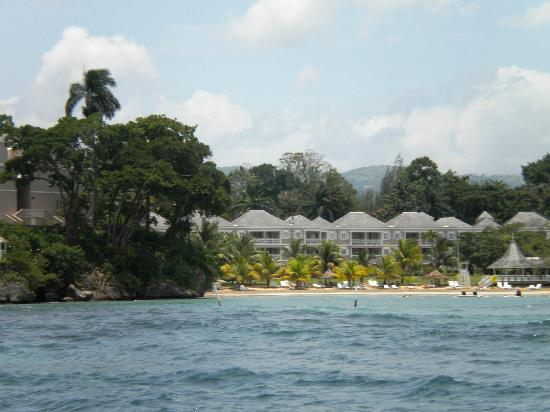 Couples Sans Souci: View from the water of the beach. Hotel rooms are in the background. Beach bar is not far away.