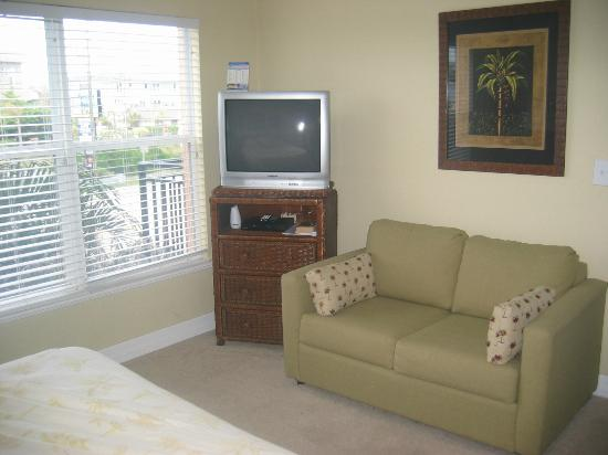 Master Bedroom has a tv and small couch - Picture of Madeira Bay ...