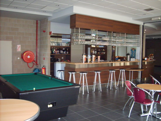 Peace Village: A well stocked bar with pool & football table!