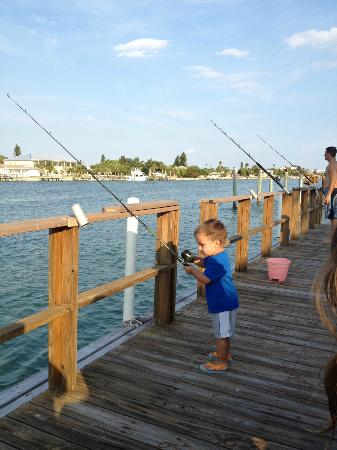 The boys fishing from the dock picture of delacado on for Fishing treasure island florida