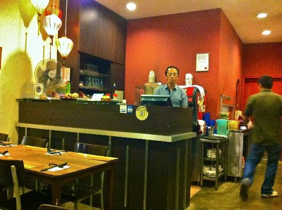 Madam Saigon: The humble boss with his pleasant waiter.