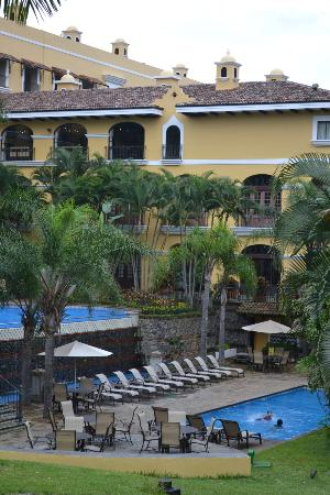 Courtyard San Jose Escazu: Back of hotel where pools are located