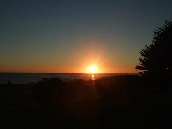 Cavalier Oceanfront Resort: Sunset from our patio!