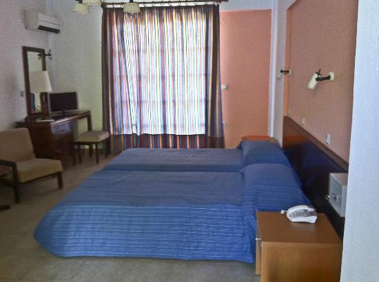 Castellania Hotel: ΕΣΩΤΕΡΙΚΟ ΔΩΜΑΤΙΟΥ