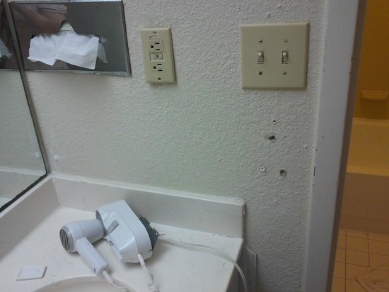 Red Roof Inn Wilmington: The hair dryer pulled from the wall and just placed on the sink, instead of fixing it!