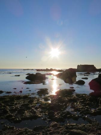 شاطئ جلاس: Sunset at Glass Beach.