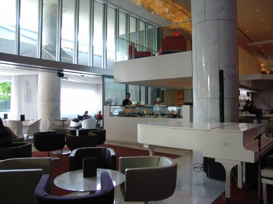 Fairmont Pacific Rim: the hall with gorgeous Fazioni white Grand Piano and the Sushi bar