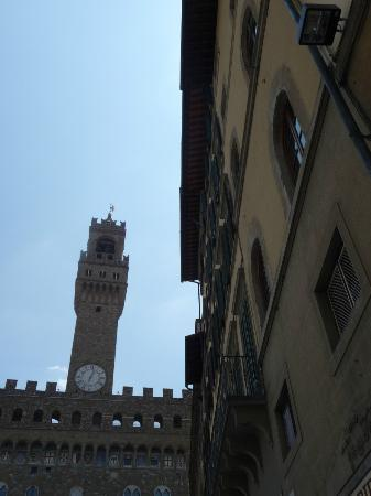 Caffetteria Tavola calda Letizia: Looking up at clock tower from Caffetteria Letizia patio