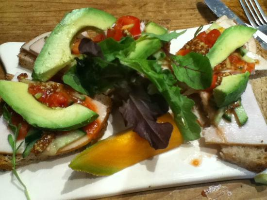 Le Pain Quotidien: Roasted turkey and avocado tartine with whole grain mustard and tomato vinaigrette