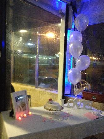 Mia Cucina Supplied us a extra table for cake, photos and balloons