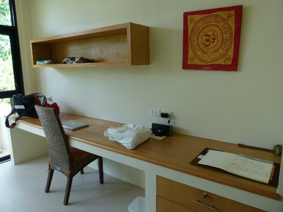 Samahita Retreat: desk and cupboard area next to window