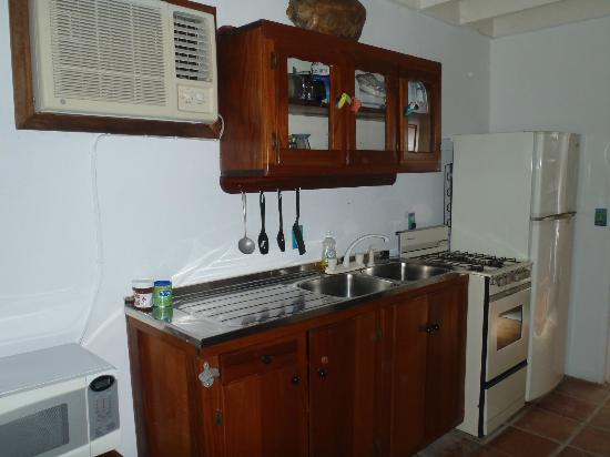 Seven Seas Resort: Rm 11 Kitchenette.  That is a turtle shell on top of the cabinets