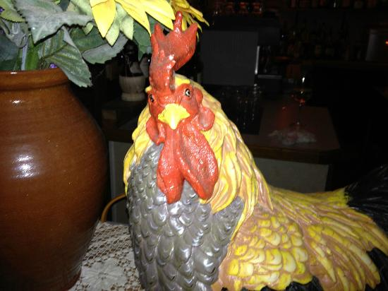 Peddler's Cafe & Grill : No, silly. It's not a real chicken. French Kitsch.