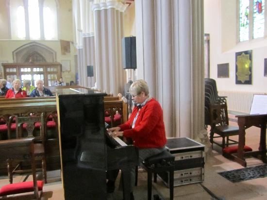 St. Patrick's Cathedral (Church of Ireland): Enjoying playing a beautiful piano!