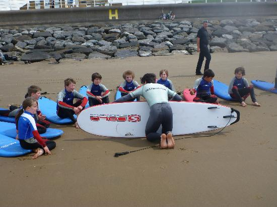 Surf School Wales: Chris giving the group a lesson about the board