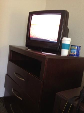 Clarion Suites: Mini TV in Living Room. Note size next to coffee cup and can of peanuts!