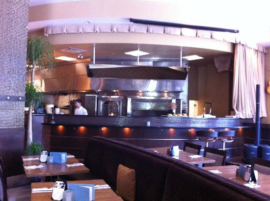 Cabana Grill: Our view of the wood fire stove from our booth-sleek, with natural wood tones to match the decor