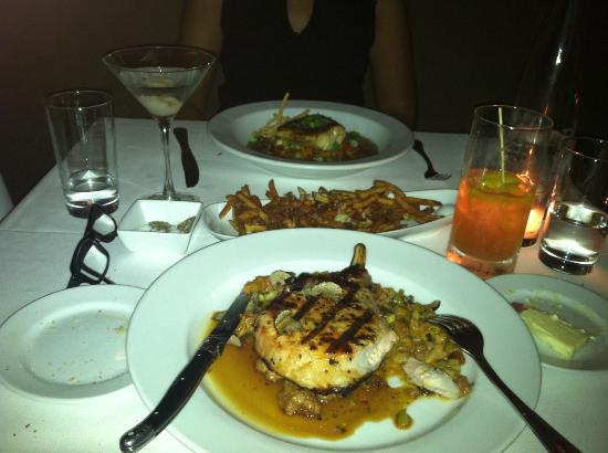 The Frisky Oyster: stuffed pork chop with sausage and the amazing grilled bass over gazpacho