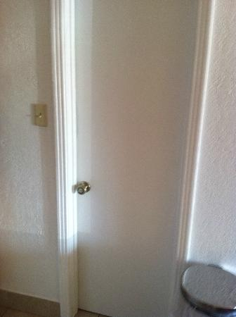 Rodeway Inn and Suites: Bathroom door in closed position