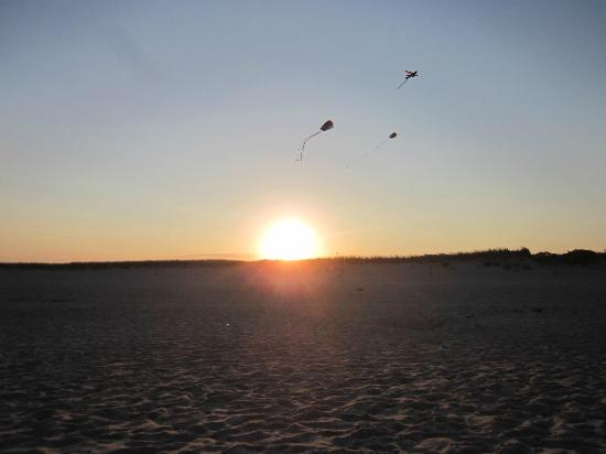 Nauset Inlet : sunset and kites flying , just before the moon rise