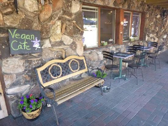 Simple Bliss Vegan Cafe: Our new completed patio dining area equipped with 2 chalkboard bistro tables and a large table a
