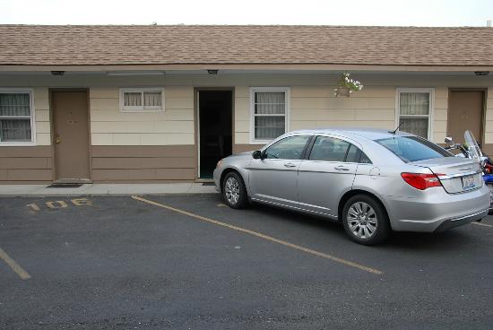 A Western Rose Motel: Parking space in front of room
