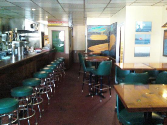 Inside Skaliwag's dining area, with kitchen / galley at left rear
