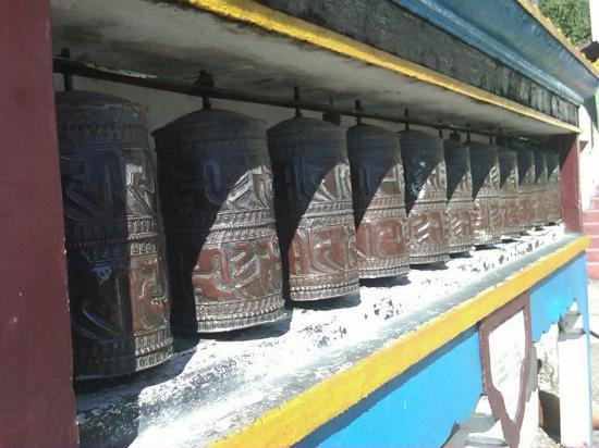 ‪‪Ghoom Monastery‬: Row of prayer wheels, at Ghoom Monastery