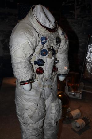 getting into his buzz aldrin space suit -#main