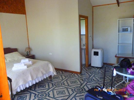 Our simple bedroom, with bathroom and small air-conditioner ...
