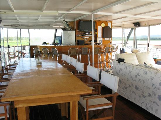 Shayamoya Tiger Fishing & Game Lodge: Bar/lounge and dining area of the houseboat