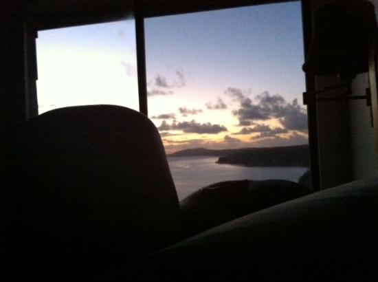 Sealodge at Princeville: Watching the sun rise over my sleeping husband.