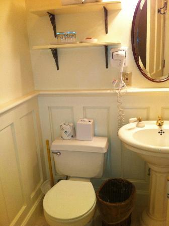Gosby House Inn - A Four Sisters Inn: Wainscoting, pedestal sink, vintage mirrors all Victorian style