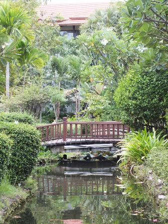Angkor Palace Resort & Spa: One of the picturesque little bridges on the grounds