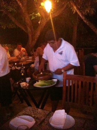Hippos Marina Lounge: Polippi ? preparing a Ceaser Salad Yummy