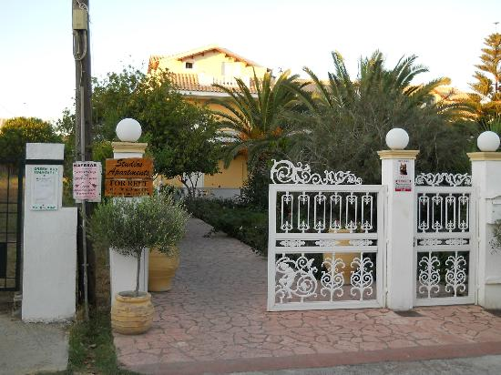 Andriana Apartments: The front gate to the gardens.